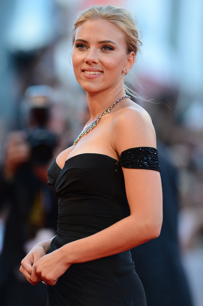 Scarlett Johansson then added major glitz to her neck via a multi-coloured bib necklace.