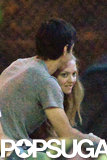 Justin Long planted a kiss on Amanda Seyfried's head.