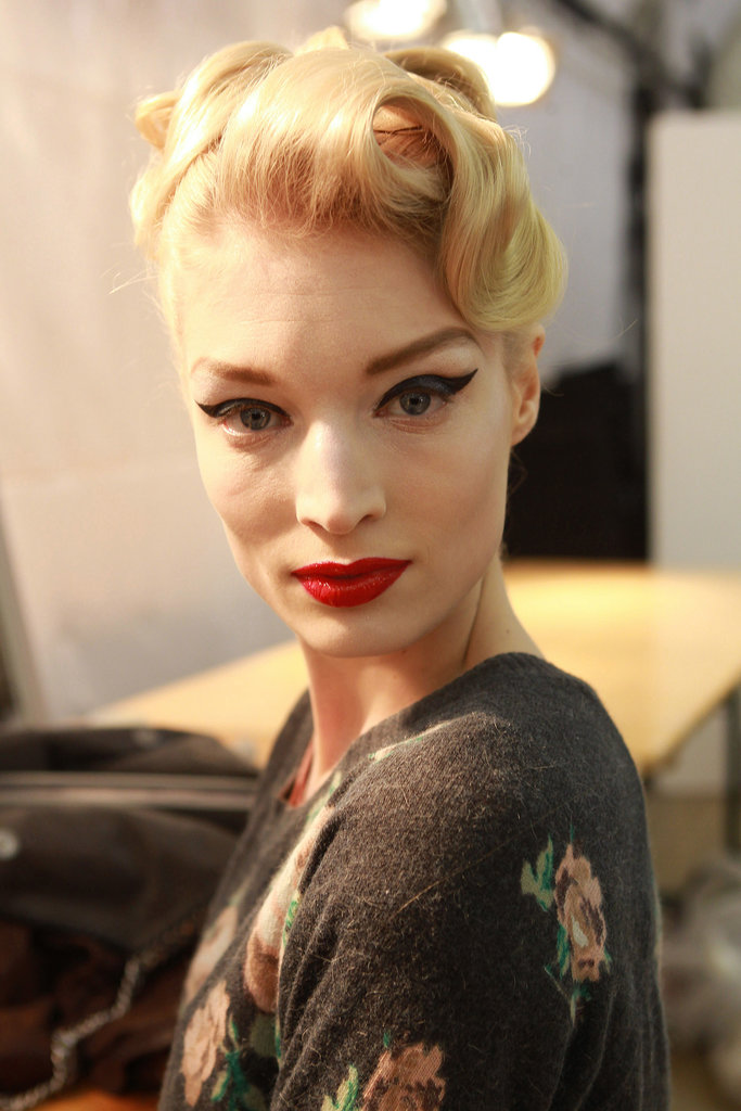 Another Dior show, another dramatic vintage-inspired beauty look! For Haute Couture Spring 2011, elegant updos with artfully placed curls were teamed with the classic flicked liner and red lip combo.