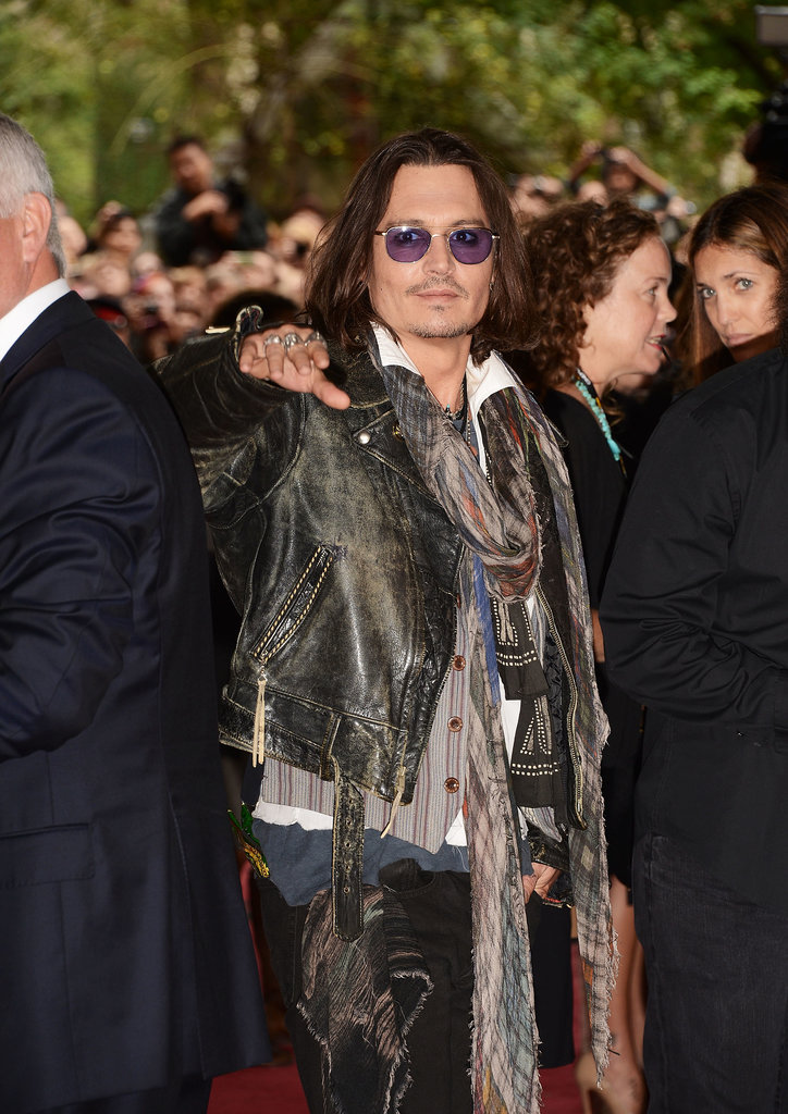 Johnny Depp gave a wave while doing press for his film West of Memphis in 2012.