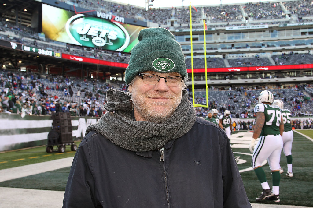 Philip Seymour Hoffman showed his New York Jets pride on the field before a game at Met Life Stadium in December 2011.