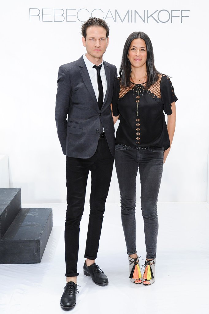Uri and Rebecca Minkoff looked sleek in black backstage before the designer's concert-like runway show.