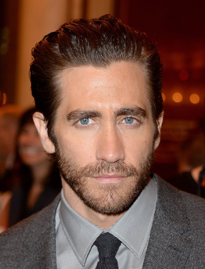 Jake Gyllenhaal sported slicked-back hair.