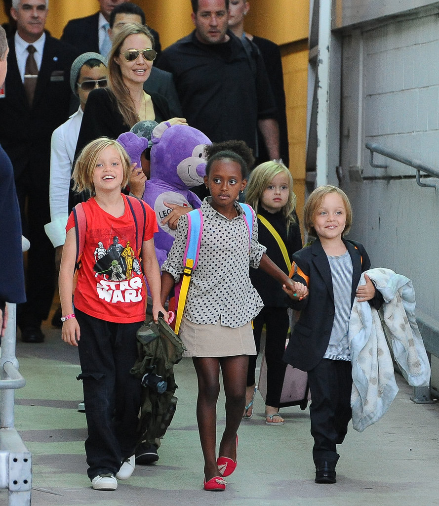 Angelina Jolie helped her kids make their way to their car.