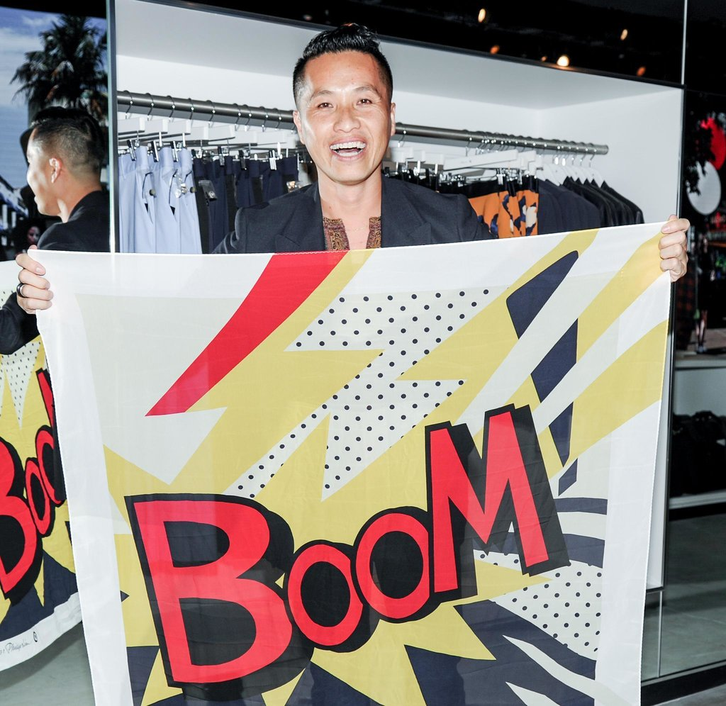 Lim posed for the camera holding up a comic-inspired scarf from the collection. Boom!
