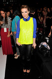 Alyssa Milano layered a neon yellow sequined top over a blue blouse, then finished with black leather pants and a polka-dot tie at the Project Runway show.