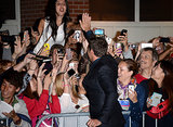 Hugh gave fans a high five.