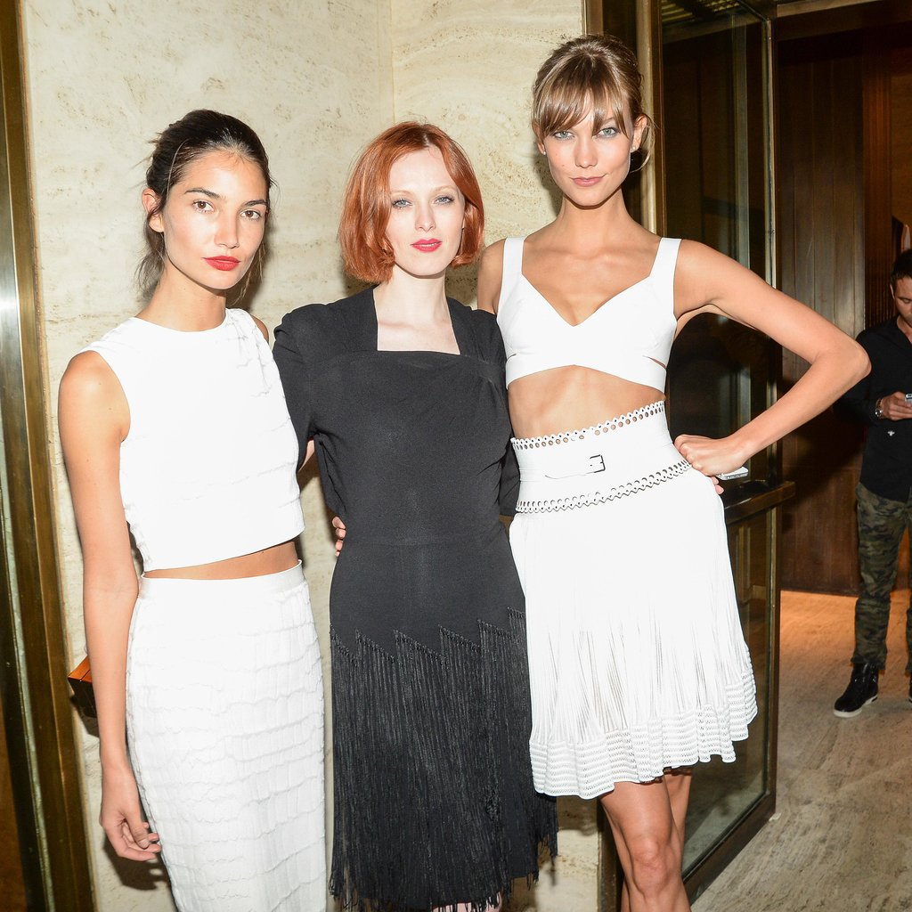 Crop top ladies Karlie Kloss and Lily Aldridge flanked Karen Elson at the Mademoiselle C afterparty.