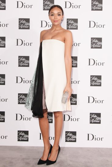At the same party, Ashley Madekwe chose a white and pink strapless dress with black pumps, both by Dior.