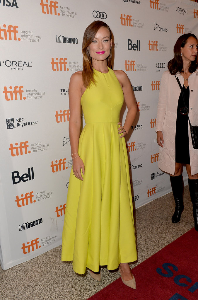 Olivia Wilde's bright yellow halter gown and Jimmy Choo pumps stood out at the Third Person premiere.
