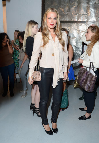 Molly Sims tucked a beautiful off-white blouse into edgier leather pants at Zac Posen.