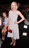 Brittany Snow's printed midi dress coordinated perfectly with her red accessories at Carolina Herrera.