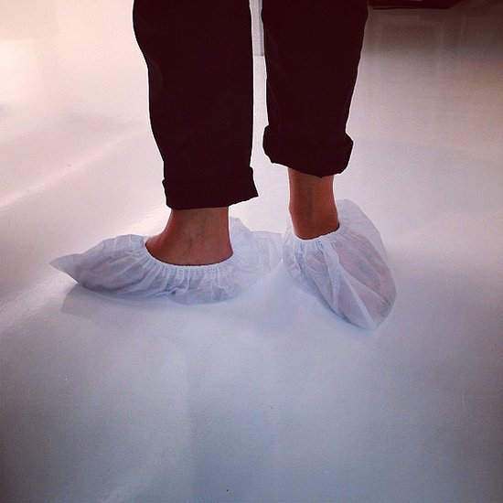 Visitors to Victoria Beckham's show space are required to wear paper booties to keep the white floors scuff-free. Source: Instagram user victoriabeckham
