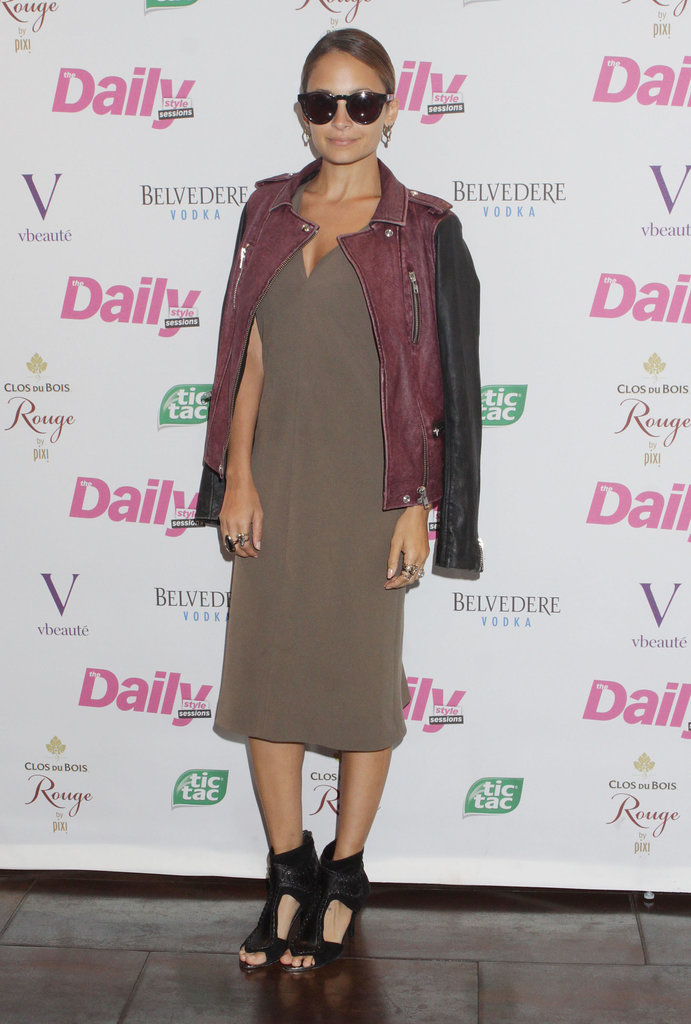Nicole Richie looked insanely cool shrugging an IRO two-toned leather jacket over her olive knee-length dress and cutout House of Harlow 1960 sandals at a New York Fashion Week party in 2012.