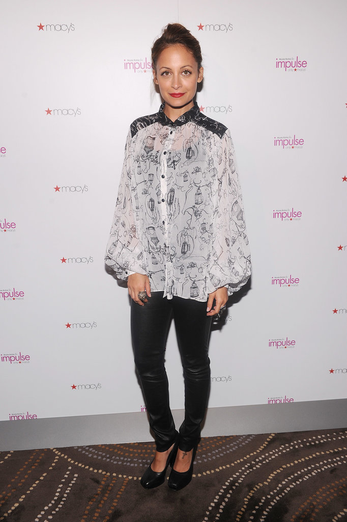 Nicole worked a printed blouse from her Nicole Richie For Impulse line with leather pants and coordinating pumps for the collection's Fall 2012 release at Macy's NYC.