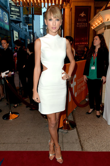 Taylor Swift wore a sexy white Calvin Klein dress with cutouts for the premiere of One Chance at the Toronto International Film Festival.