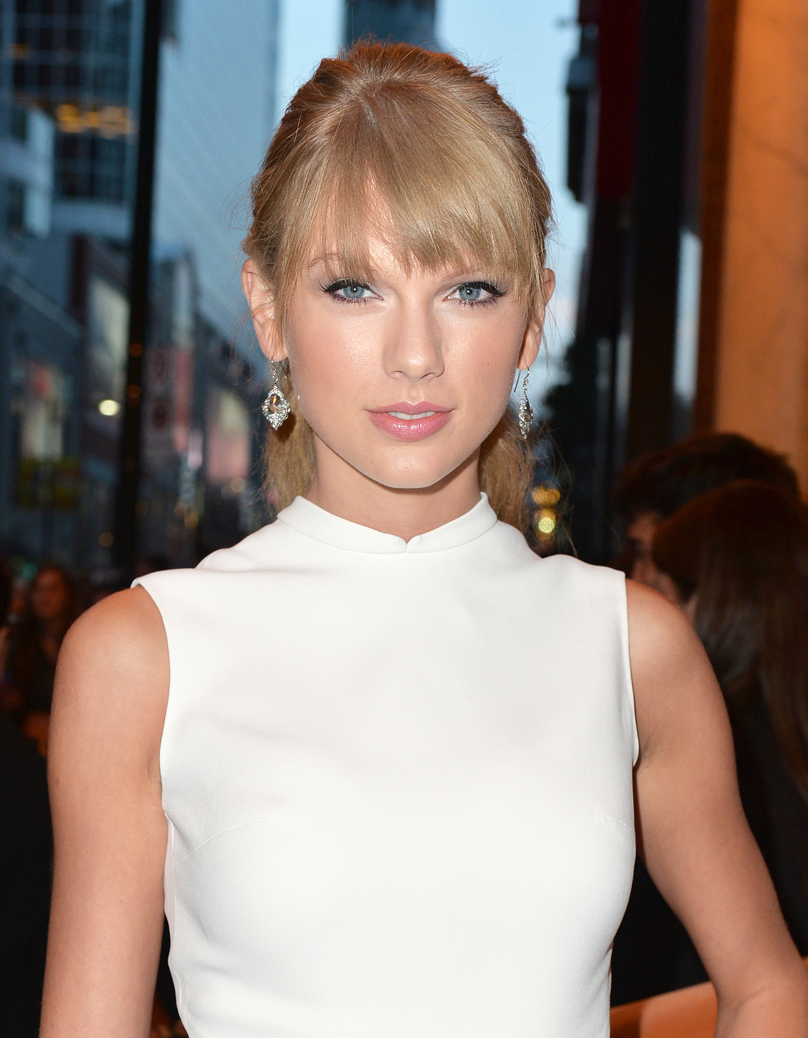 Taylor Swift arrived at the One Chance premiere with her hair pulled back into a ponytail and her bangs framing her face.