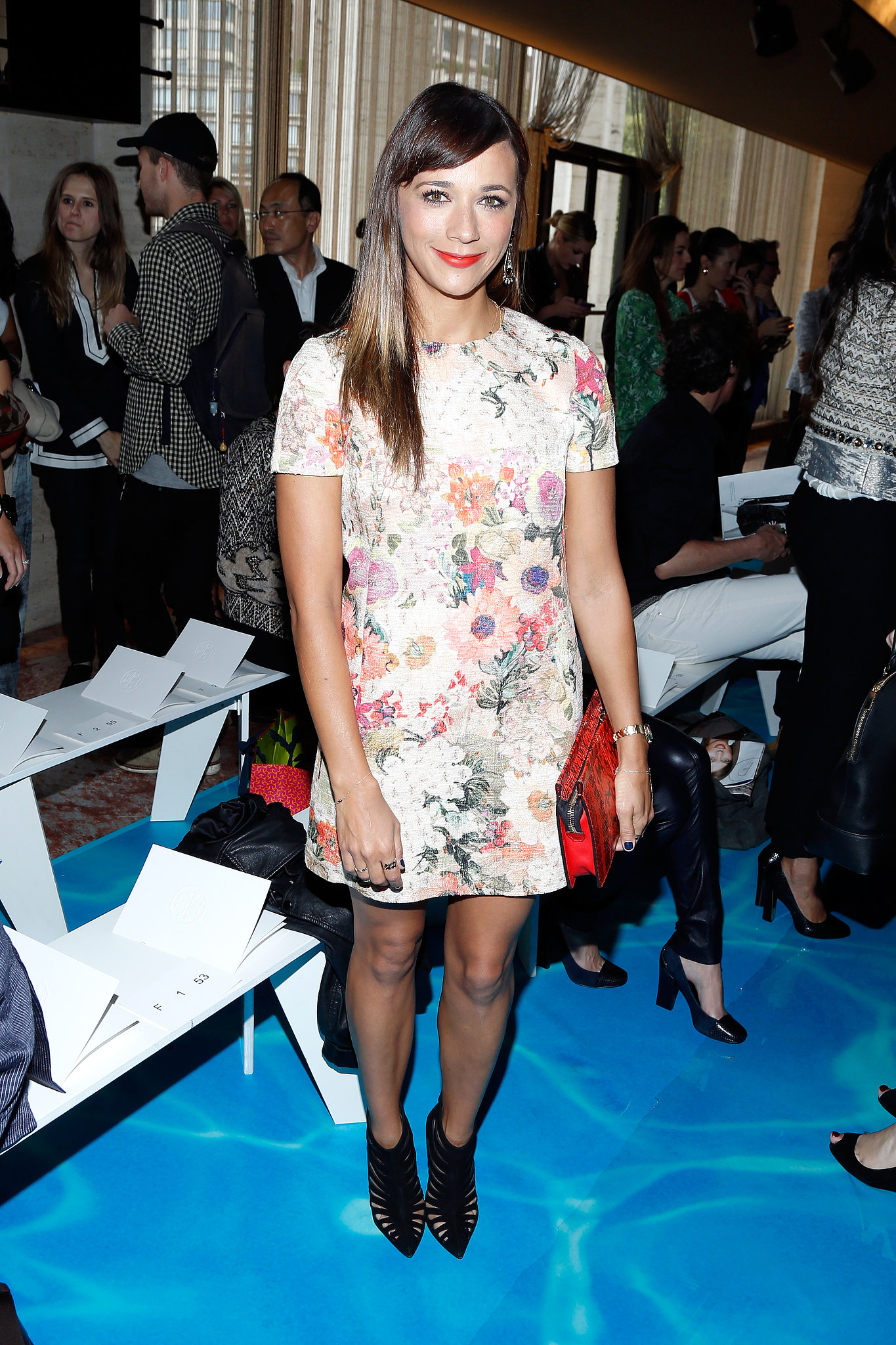 Rashida Jones dressed in a happy floral Tory Burch minidress and caged booties at the designer's Spring 2014 show.