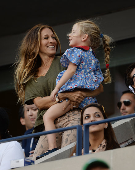 Sarah Jessica Parker balanced her printed denim with an olive t-shirt while playing around with her daughter at the US Open.