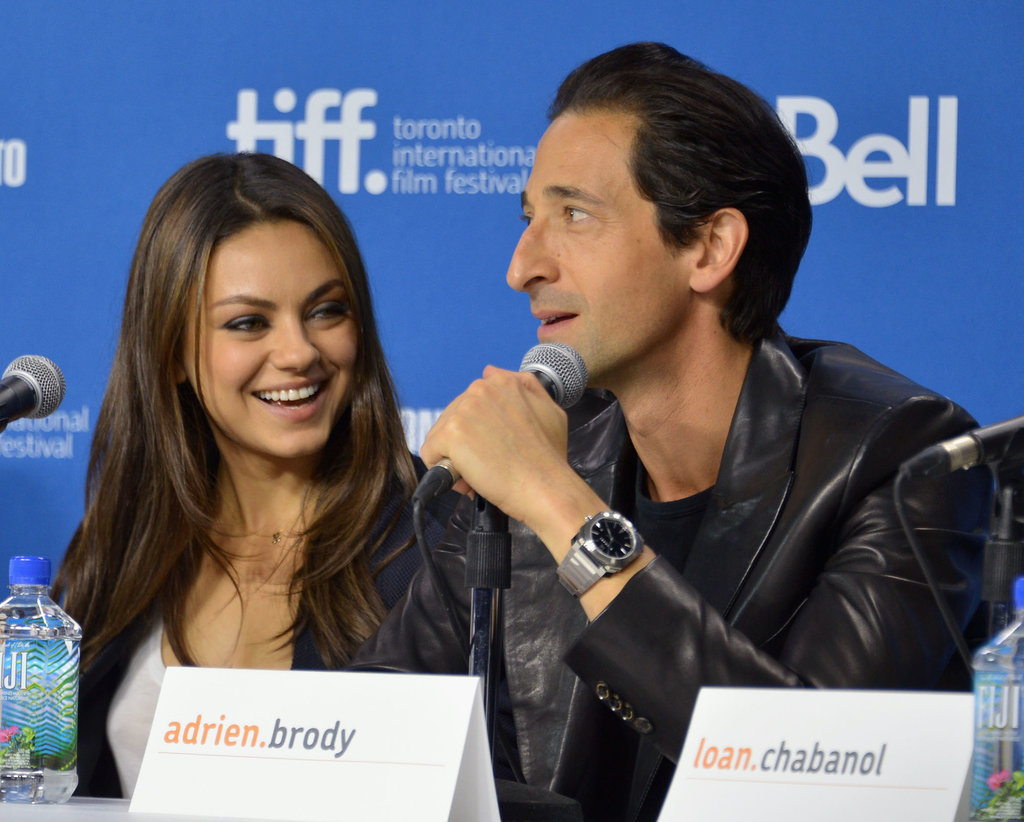 Mila Kunis laughed while Adrien Brody spoke at the Third Person press conference.