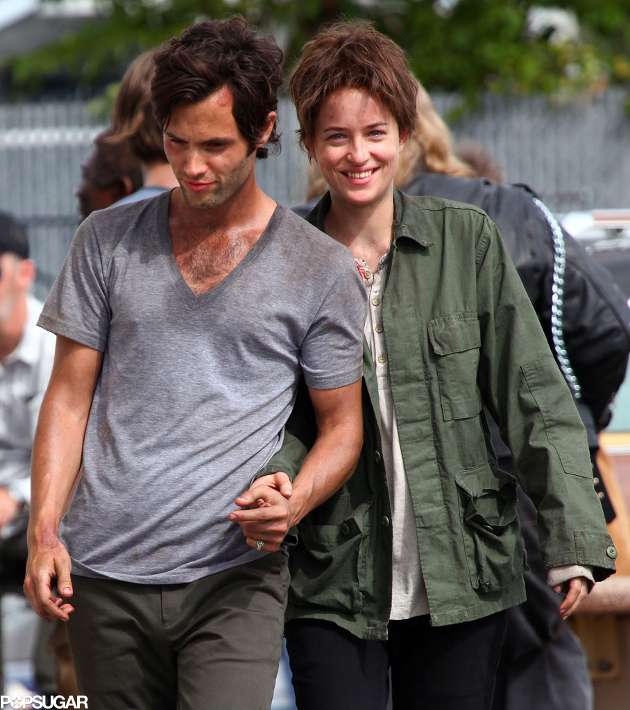 Penn Badgley was with Dakota Johnson, who looked almost unrecognizable wearing a wig, on the NYC set of Cymbeline on Monday.