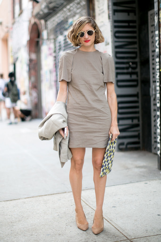 A neutral sheath is the perfect counter to cool shades and a printed clutch.