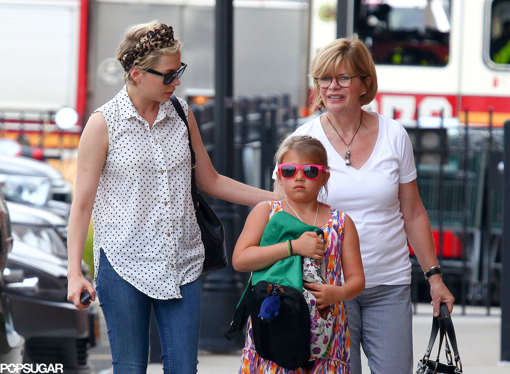 Matilda Ledger held her backpack for a walk with Michelle Williams and her grandma, Carla Williams.