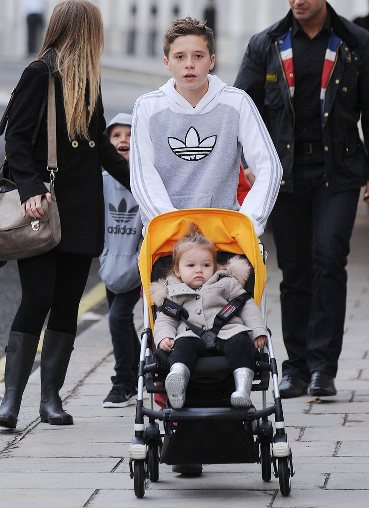 Brooklyn Beckham has also gotten in some practice pushing Harper in her stroller — this time they were strolling around London.