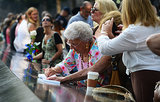A woman made a rubbing of a name on the 9/11 Memorial during the anniversary ceremonies in NYC.