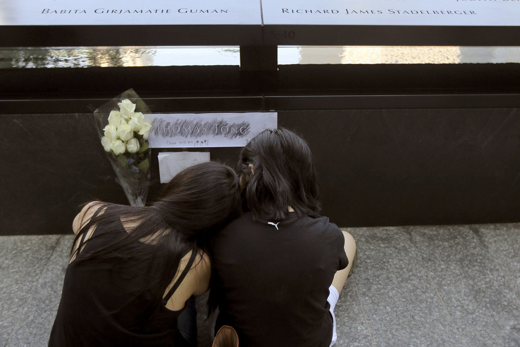 Elena and Elissa Tong mourned their husband and father, Thomas Tong, at the 9/11 Memorial in NYC.