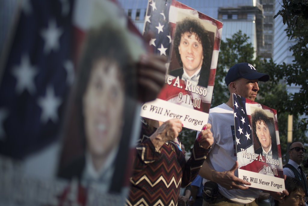 Friends and family of Wayne A. Russo held up signs with his picture on it during the 9/11 anniversary ceremonies in NYC.
