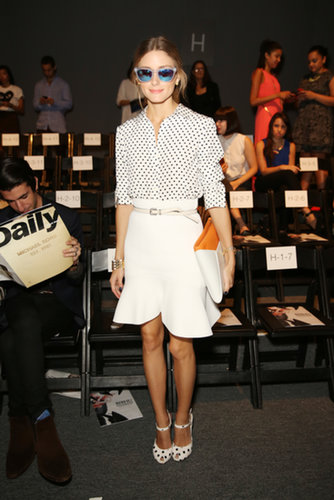 Olivia Palermo kept chic in a polka-dot blouse, a white flared skirt, Westward Leaning sunglasses, and matching polka-dot sandals at Bibhu Mohapatra.