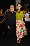 Katie Holmes posed backstage with designer Michael Kors at his Spring 2014 runway show during NYFW.