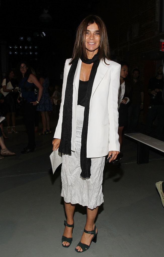 Carine Roitfeld layered up in a scarf and blazer at the Wes Gordon runway show.
