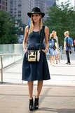 Chiara Ferragni was a bit boho inspired in a wide-brim hat and booties to counter her fit-and-flare dress and Céline bag.