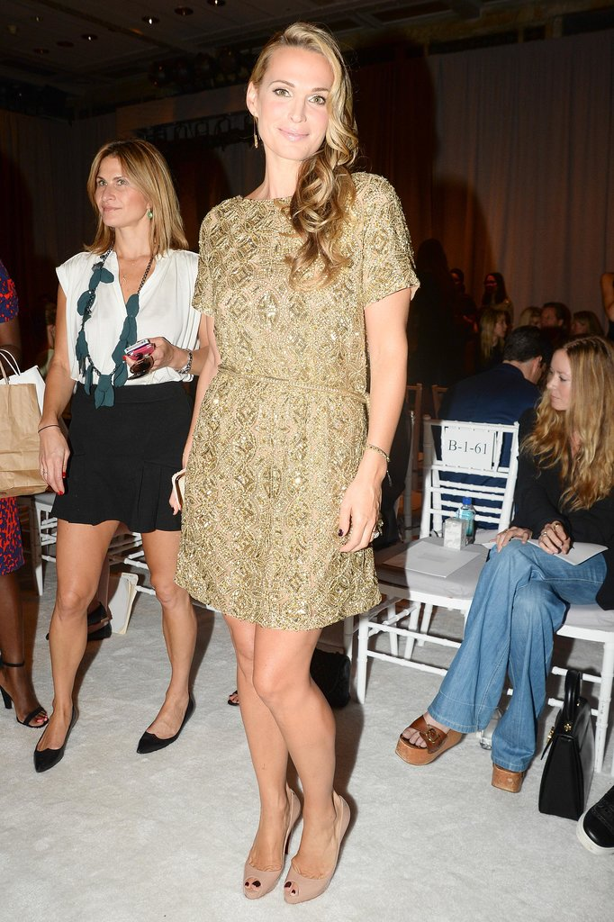 Molly Sims was a golden girl in an embroidered Marchesa minidress at the designer's show.