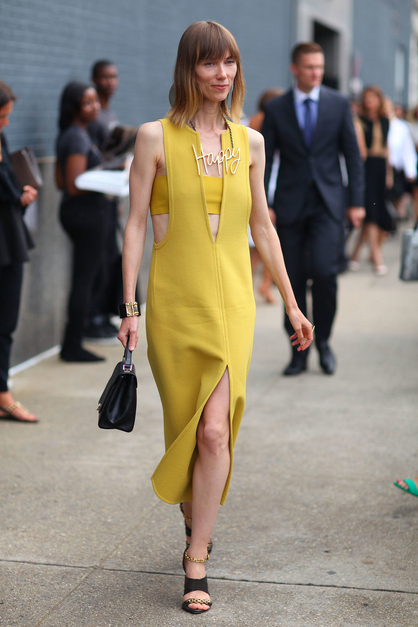 Anya Ziourova made us happy in her sunny yellow dress.
