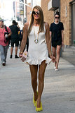 Never one to shy away from a bold accessory, Anna Dello Russo added Céline's bright fuzzy pumps to her LWD.