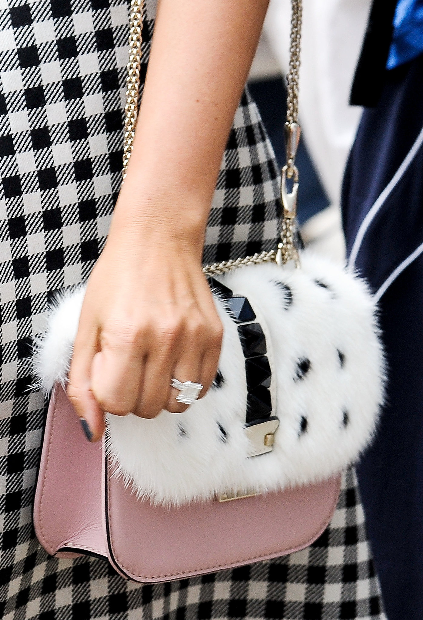 Texture meets a pretty pale pink on this Valentino bag.