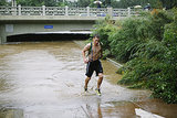 A runner jogged along Boulder Creek in Colorado.
