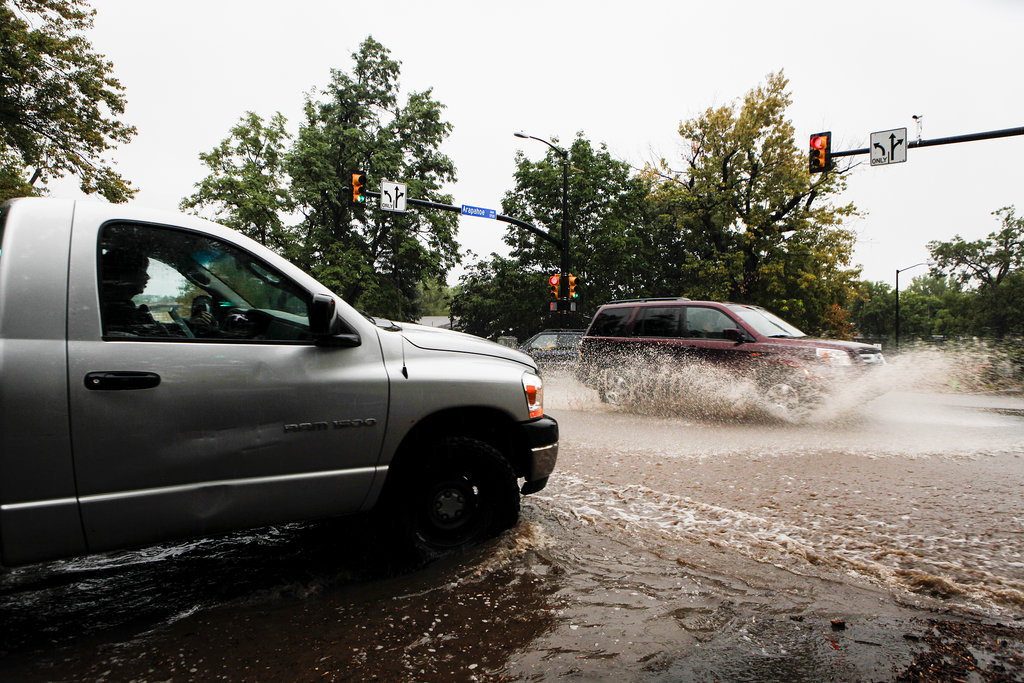 Cars made their way through the flooded streets in Colorado.