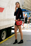 Karlie Kloss punctuated her outfit with a cherry-red bag.