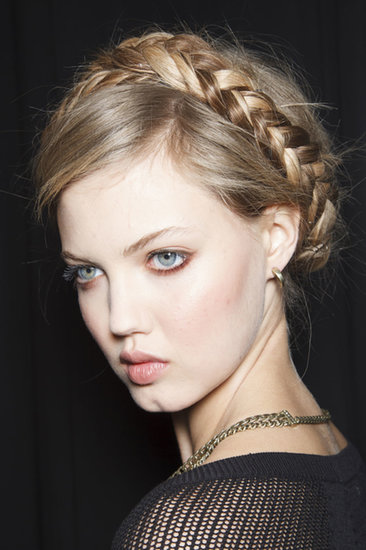 """The trick to parting your hair for milkmaid braids is to keep the part messy. I use the end of my comb to make a zigzag all the way to the back of the head.""  — Hairstylist Jeanie Syfu at Rebecca Minkoff (as modeled by Lindsey Wixson, pictured)"