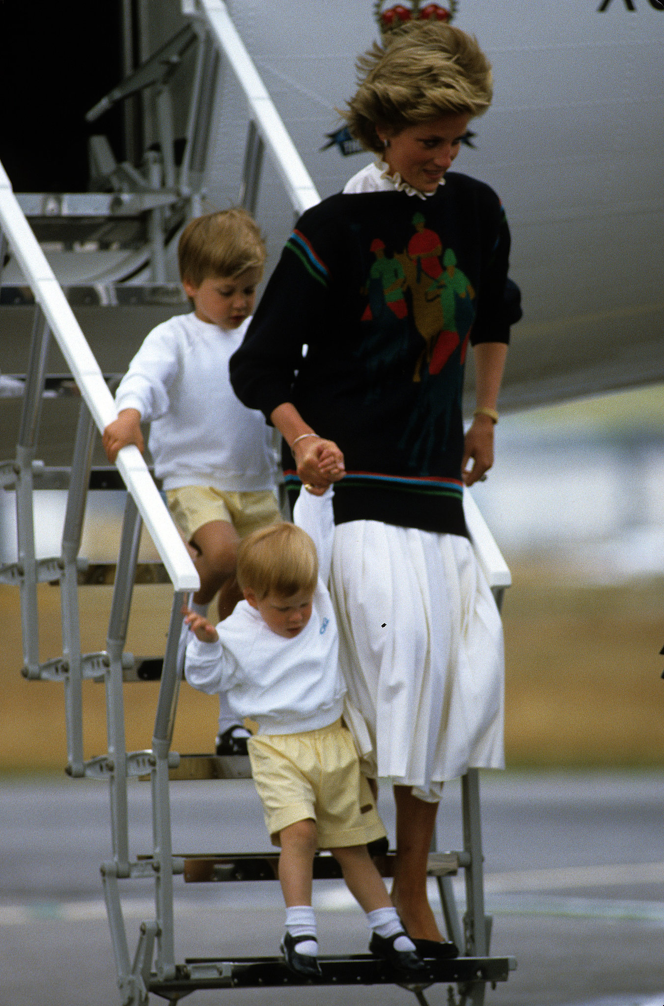 Prince Harry showed off his walking skills as he departed a plane in Scotland in 1986.