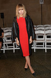 Suki Waterhouse wore a red dress to take a front-row seat at Jonathan Saunders.