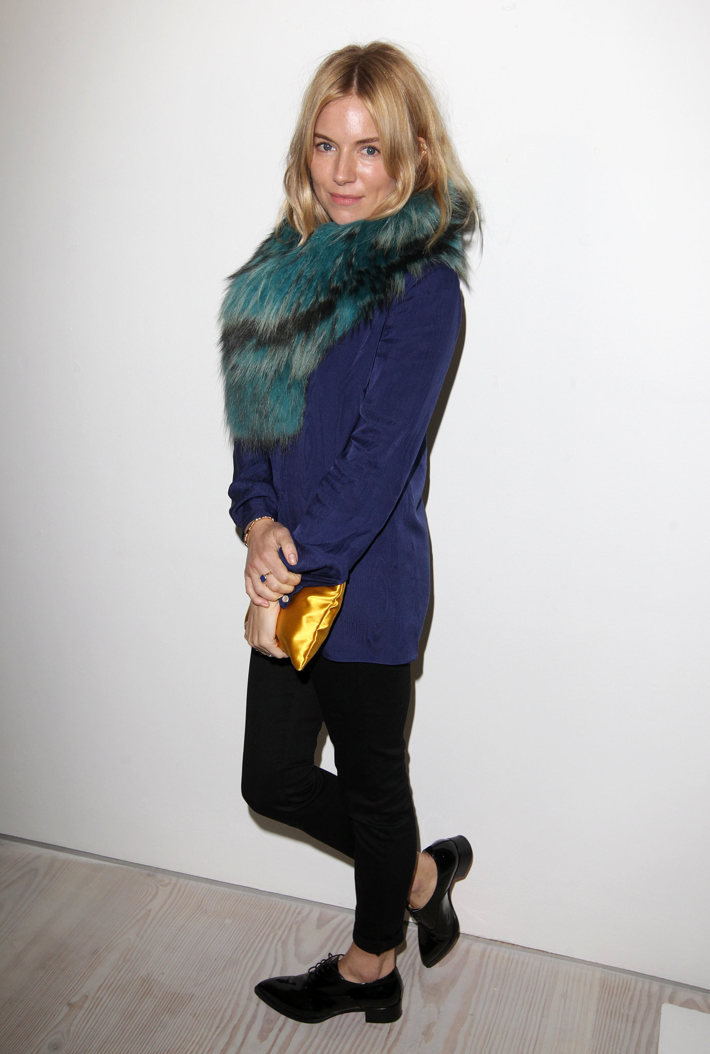 Sienna Miller wore a fur scarf to Matthew Williamson's show.