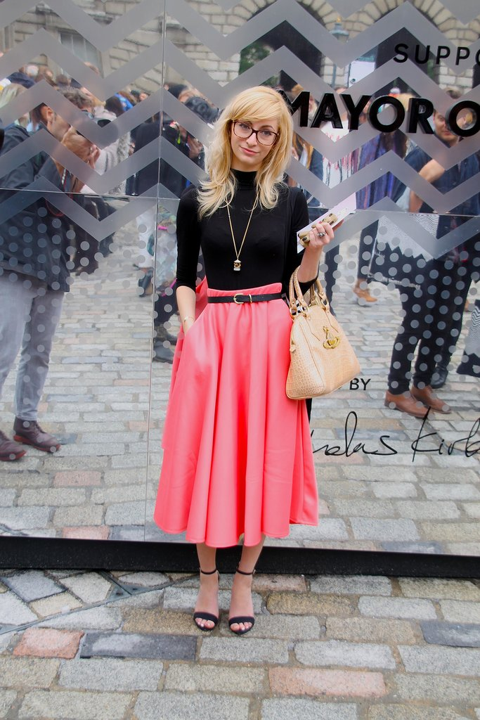 A pop of pink makes the look.  Source: Hannah Freeman