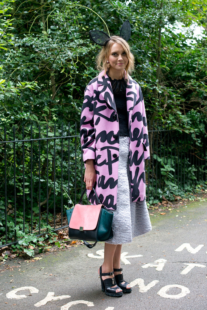 This showgoer didn't shy away from statement-making pieces, opting for bunny ears, a graffiti-printed coat, and a bright, colorblock Céline bag.