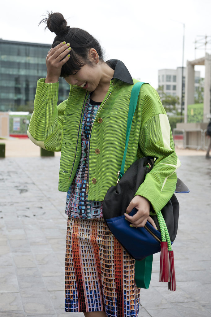 Susie Bubble decked out her bright look with a backpack.