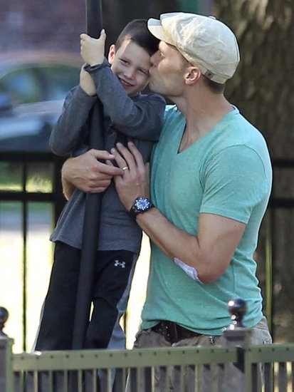 Tom Brady gave his son John a smooch at a park in Boston on Sunday.